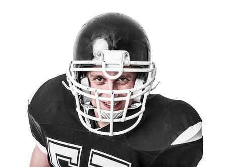 crouches: American football player close-up isolated on white background.