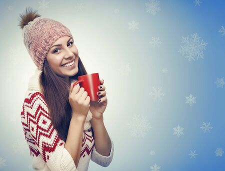 Beautiful young girl on the new year and christmas background with snowflakes. Toned photo.