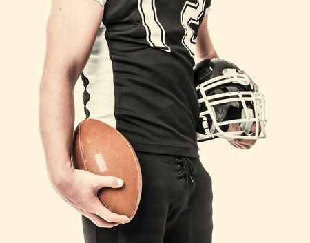 crouches: American football player on white background.