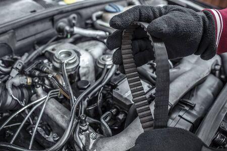 replacing: Replacing the belt. Car repair. Under the hood of the car. Toned photo. Stock Photo