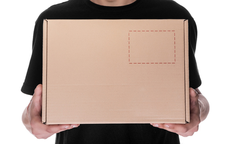 cardbox: Delivery man holding a cardbox isolated on white background. Stock Photo