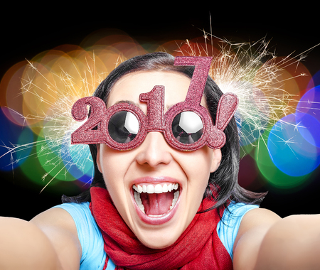 Two thousand and seventeen. 2017. Girl in glasses taking selfie. New Years concept. Stock Photo