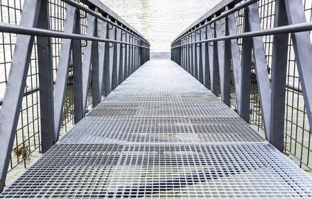 metal structure: Bridge or pier built of steel structures. Stock Photo