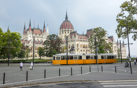 tramcar: BUDAPEST, SEPTEMBER 17: Yellow tram in Budapest, Hungary on September 17, 2016 in Budapest, Hungary. Yellow tram in Budapest goes from all the historical attractions of the city.