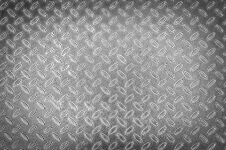 rough diamond: Background of metal plate in silver color. Added vignetting.