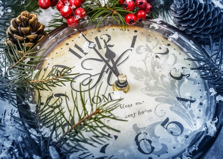 chock: Christmas still life. Old clock on snow and Christmas tree branches. Stock Photo