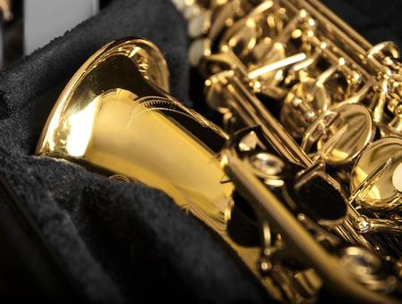 Saxophone detail against the background of a dark velvet cover.