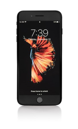 UZHGOROD, UKRAINE - DECEMBER 13, 2016: New black iPhone 7 Plus from the company Apple on a white background, studio photo. The iPhone 7 Plus overall design is similar to the iPhone 6S Plus, but introduces new color options, water and dust resistance, a ne
