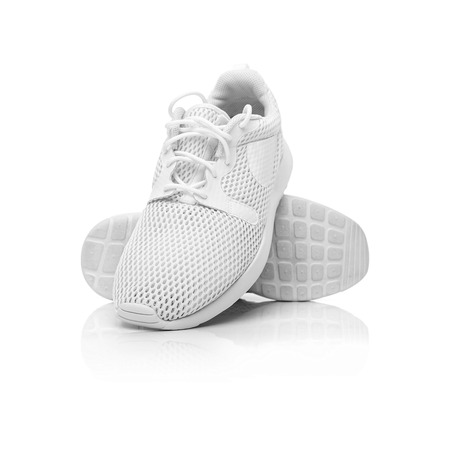 White unbranded sneakers.