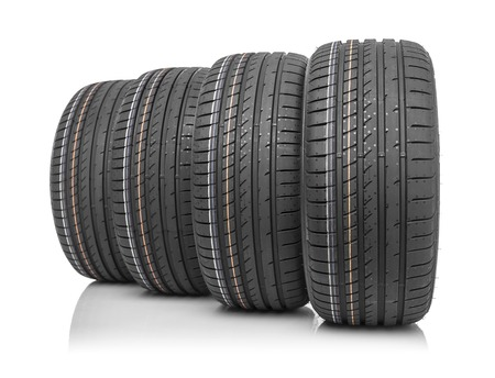 New car tires isolated on white background. Stock Photo
