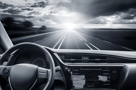 go inside: Car rushes along the highway. Toned photo. Stock Photo