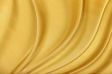 Gold silk texture of satin abstract background.