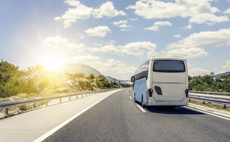 Bus rushes along the asphalt high-speed highway.