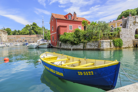 Pleasure boats and fishing boats on the pier in Fosa Bay in the spa town of Zadar in Croatia.