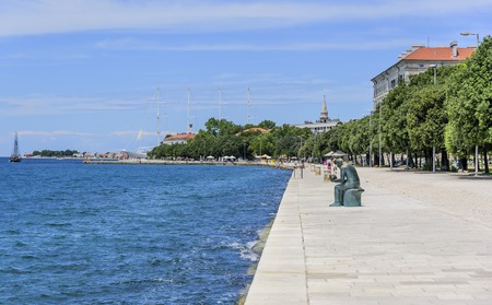 The embankment of the city of Zadar on a sunny summer day. Zadar, one of the most popular cities in Croatia in the tourist season.