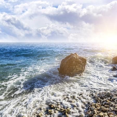 Sea beach. Sea waves crashing against the rocks on the coast. Stock Photo