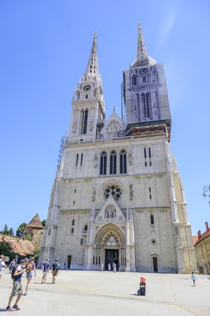 angels fountain: Zagreb cathedral, one of the towers of the cathedral is tightened with awning during the restoration. Editorial