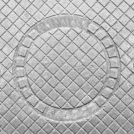 Decorative cast-iron cover of the sewer hatch.