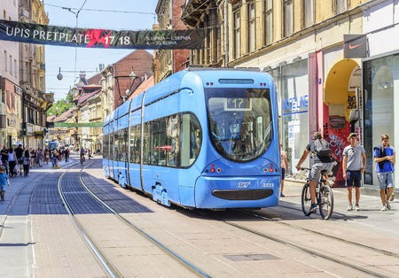 Square Ban Josip Jelacic with tourists and trams on a summer day in Zagreb.