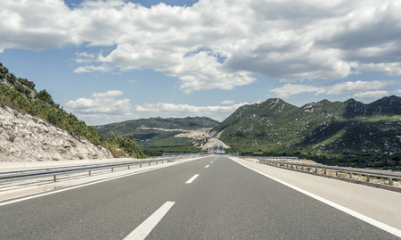 curve road: Highway outside the city receding into the highlands.