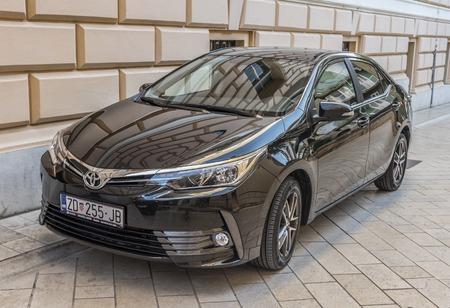 New Toyota Corolla in the street.