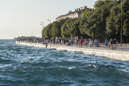 ZADAR, CROATIA - JULY 15, 2017: View of the embankment with tourists in the city of Zadar in the region of Dalmatia in Croatia.