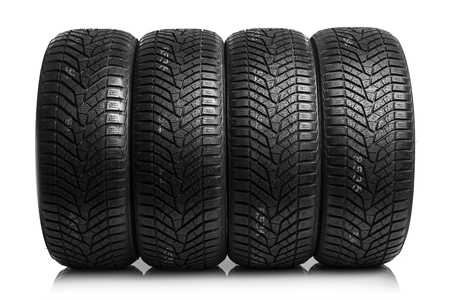 Winter car tires. Group of tires for winter driving on a white background.
