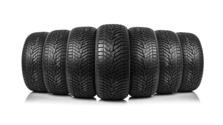 traction: Winter car tires. Group of tires for winter driving on a white background.