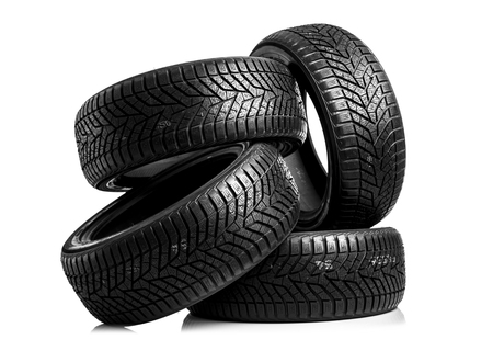 traction: Winter tires on a white background. Stock Photo