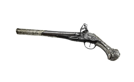 Ancient pistol or musket on a white background. Foto de archivo
