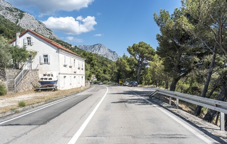 An automobile road along the sea coast of the resort area of Makarska Riviera in Croatia.
