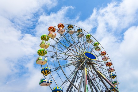 Colorful Ferris wheel against the blue sky.