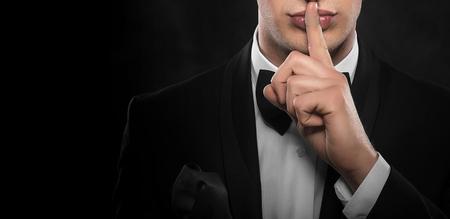Man gesturing silent.