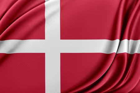 Denmark flag with a glossy silk texture. Reklamní fotografie - 105412189