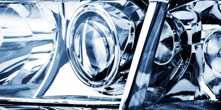 Automobile lenticular headlamp in blue tones is shot close-up. Reklamní fotografie