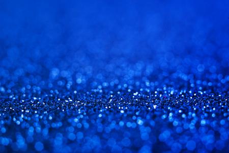 Blue glitter. Shiny blue abstract christmas background. Stockfoto