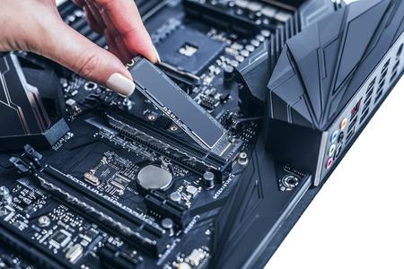 Hard disk SSD m2 on the motherboard background. Stok Fotoğraf - 110877436