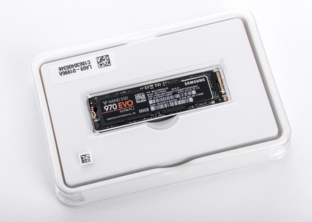 Box of Samsung 970 Evo SSD drive on white background.