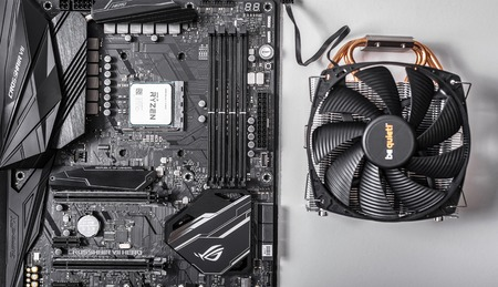 Processor Ryzen 7 2700X against the background of a computer motherboard Asus rog crosshair vii hero, and cooler be quiet .