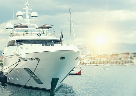 White yacht at the marina in the evening. 스톡 콘텐츠