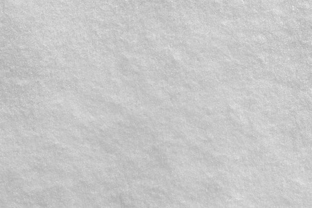 Texture of white snow as a background.