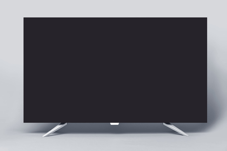 Modern TV or PC monitor on gray background.