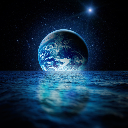 Fantastic space landscape. Planet Earth is reflected in the waters of the ocean with a myriad of stars.