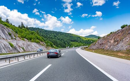 Audi A4 moving on highway.