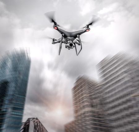 Dark drone flies on the background of downtown skyscrapers.