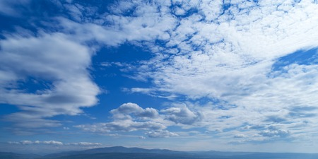 Sky with white clouds and horizon line. Stock Photo