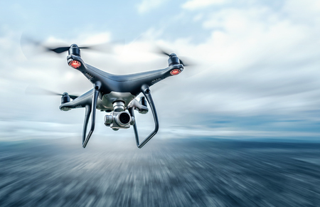 Drone in flight over the city. Stock Photo