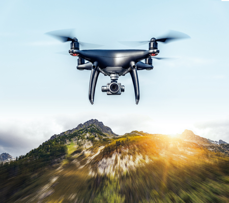 Drone flies in the mountains.