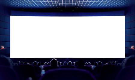Biały ekran w kinie i publiczność oglądająca film. Kino. Zdjęcie Seryjne