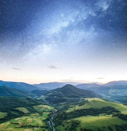 Starry sky against a mountain landscape.